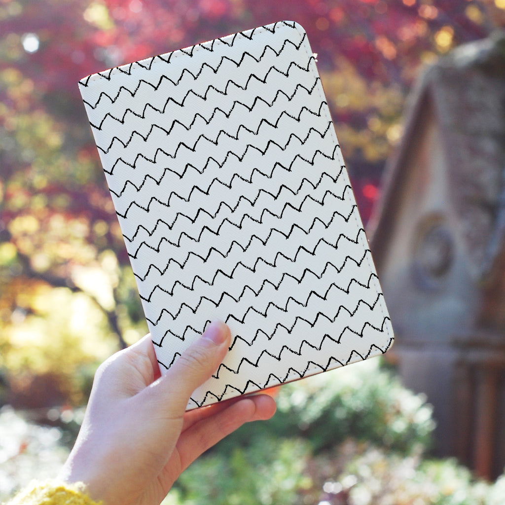 a girl holding personalized RFID blocking passport travel wallet with Black Seamless Patterns design