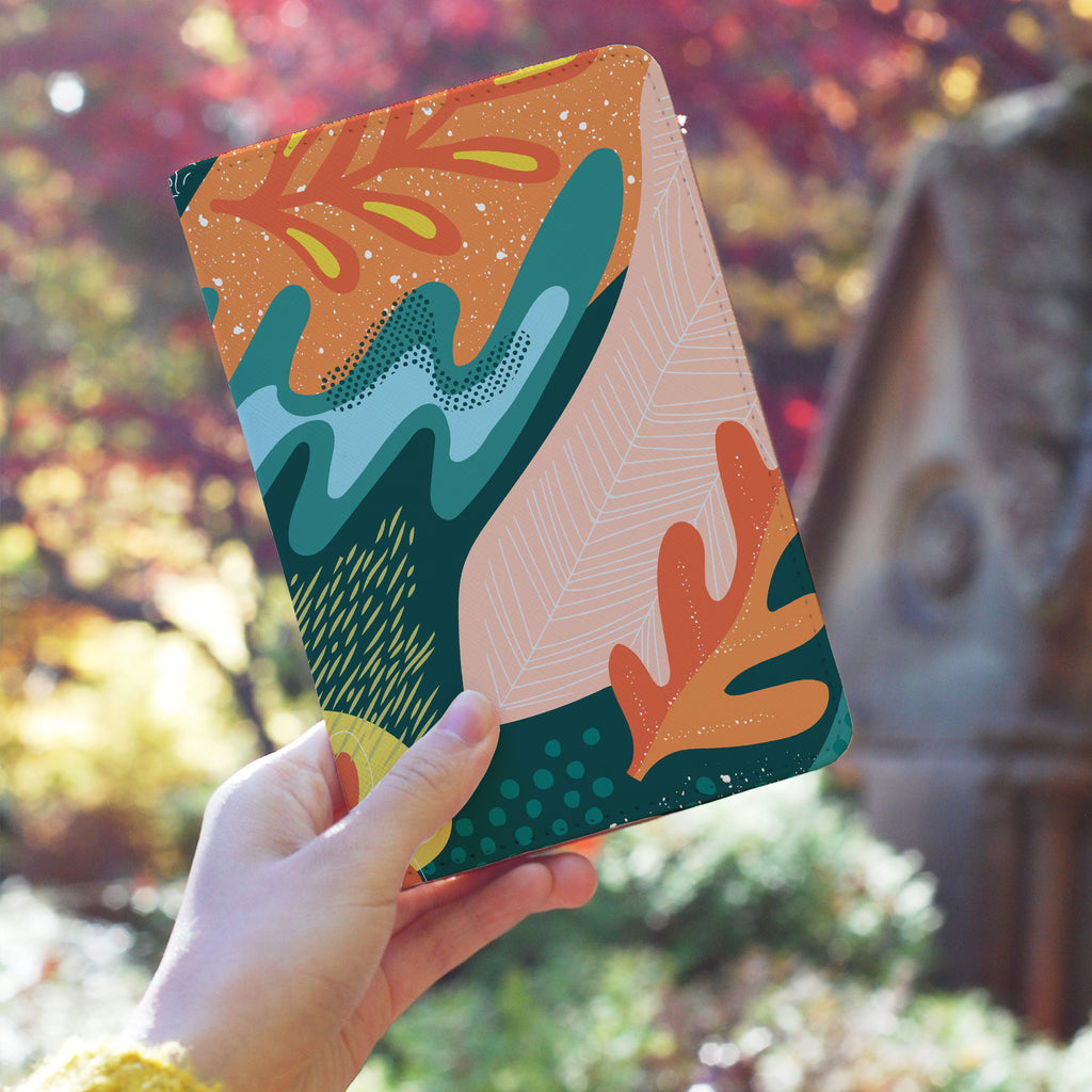 a girl holding personalized RFID blocking passport travel wallet with Collage Patterns design