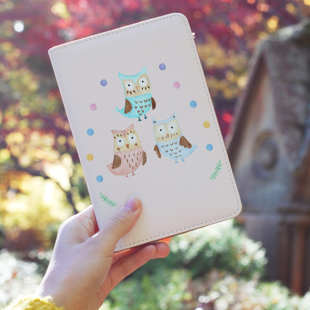 a girl holding personalized RFID blocking passport travel wallet with Happy Owls design