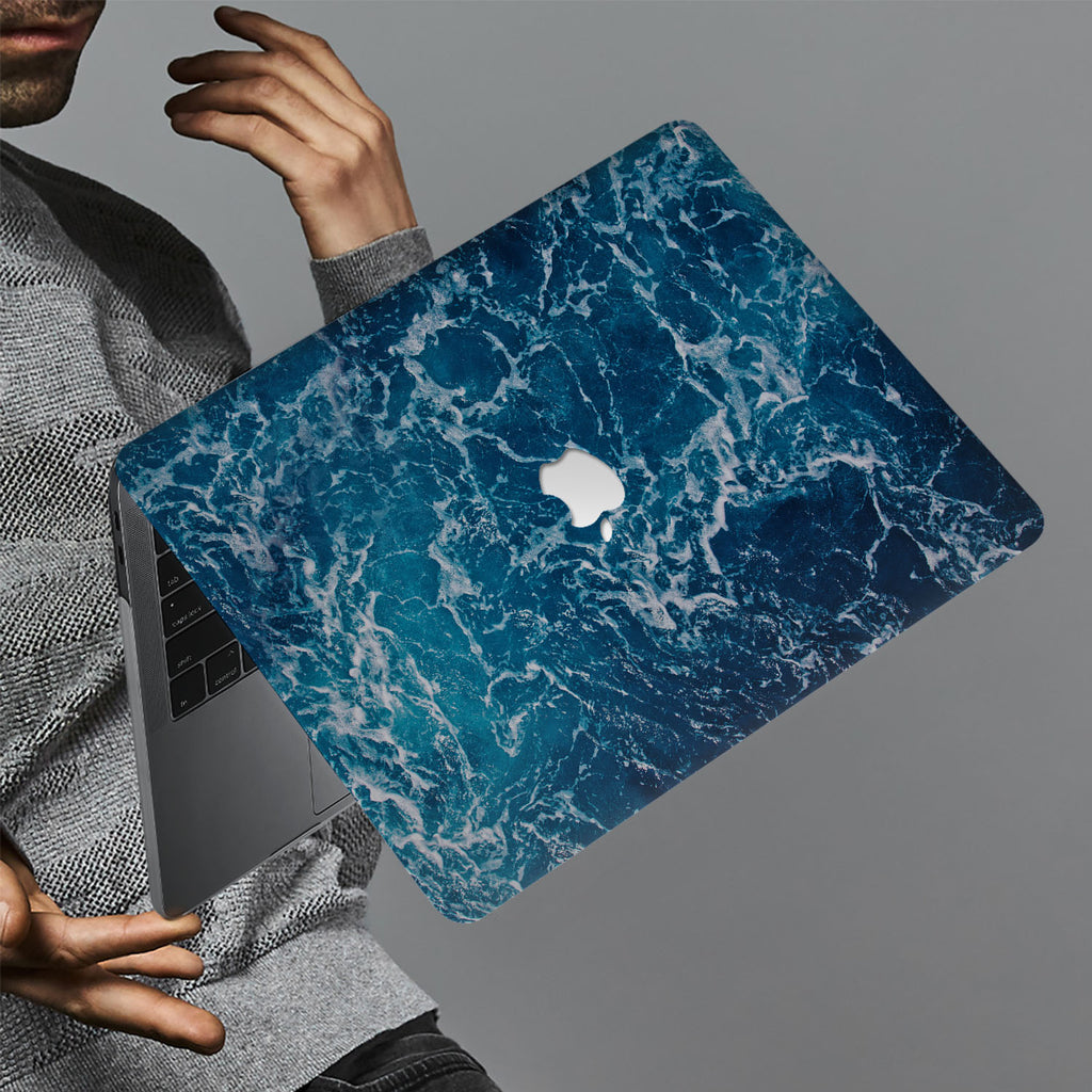 hardshell case with Ocean design holds up to scratches, punctures, and dents