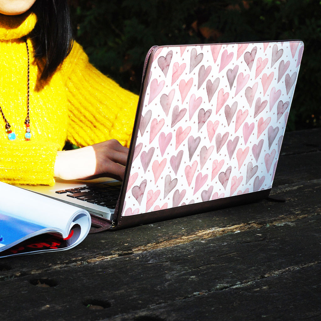 a girl using macbook air with personalized Macbook carry bag case with Love design on a wooden table