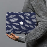 hardshell case with Feather design combines a sleek hardshell design with vibrant colors for stylish protection against scratches, dents, and bumps for your Macbook