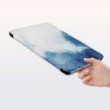 a hand is holding the Personalized Samsung Galaxy Tab Case with Abstract Ink Painting design