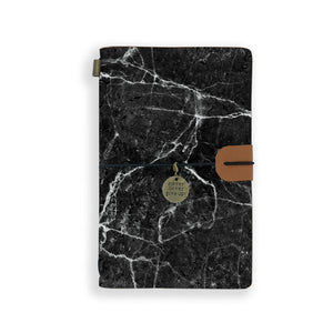the front top view of midori style traveler's notebook with moody marble design