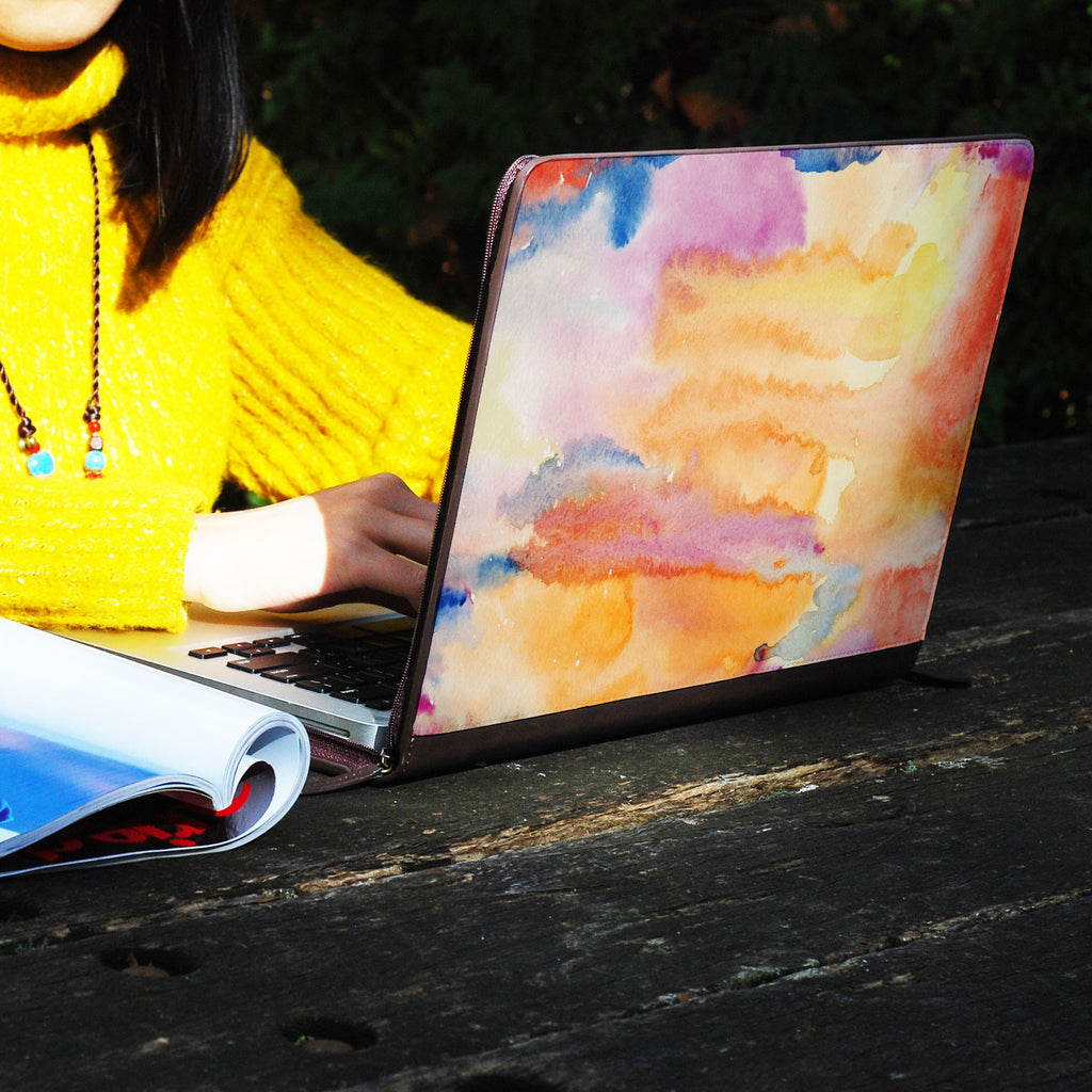 a girl using macbook air with personalized Macbook carry bag case with Splash design on a wooden table