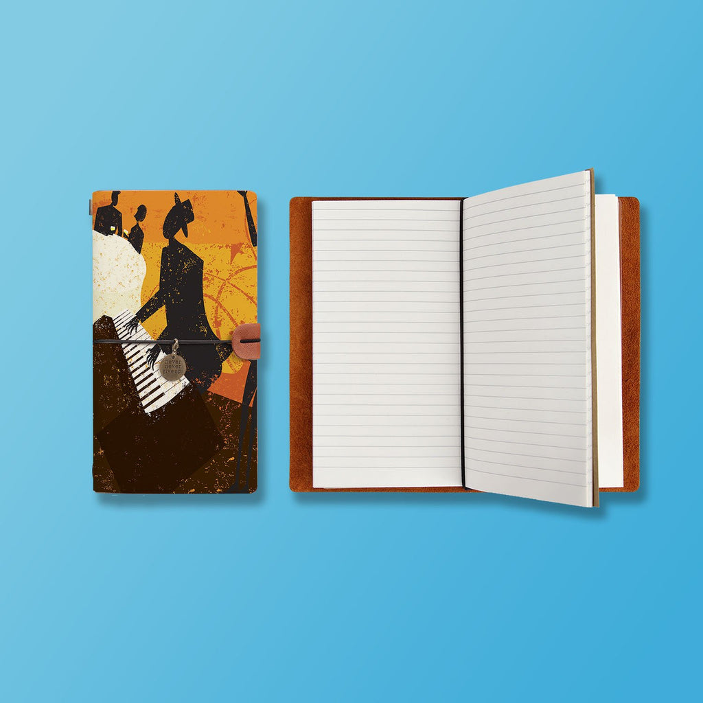 the front top view of midori style traveler's notebook with Music design