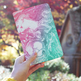 a girl holding personalized RFID blocking passport travel wallet with Abstract Oil Painting design
