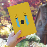 a girl holding personalized RFID blocking passport travel wallet with Emoji 2 design