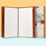 the front top view of midori style traveler's notebook with Travel design