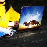 a girl using macbook air with personalized Macbook carry bag case with Horse design on a wooden table