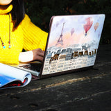 a girl using macbook air with personalized Macbook carry bag case with Travel design on a wooden table