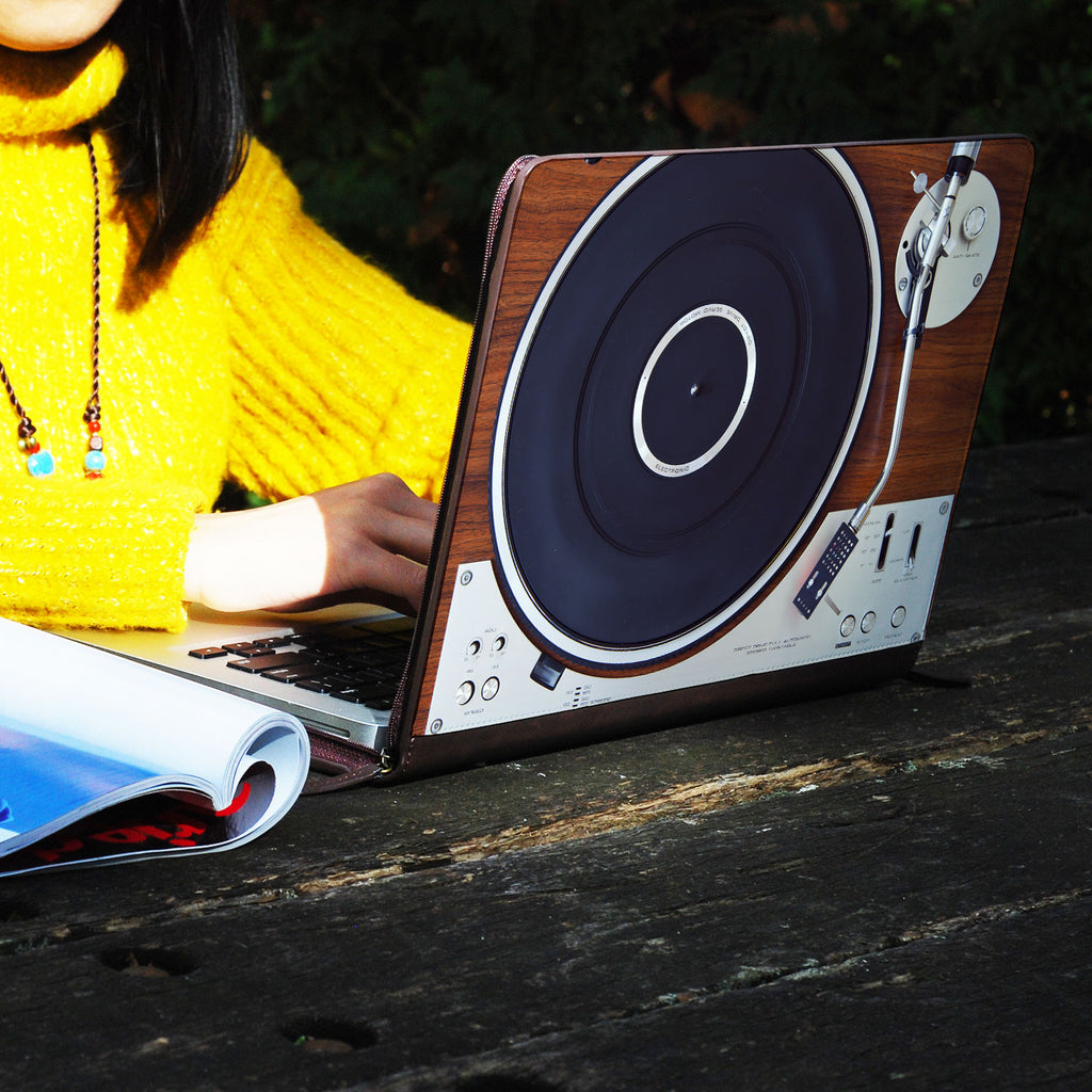 a girl using macbook air with personalized Macbook carry bag case with Retro Vintage design on a wooden table
