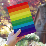 a girl holding personalized RFID blocking passport travel wallet with Rainbow design