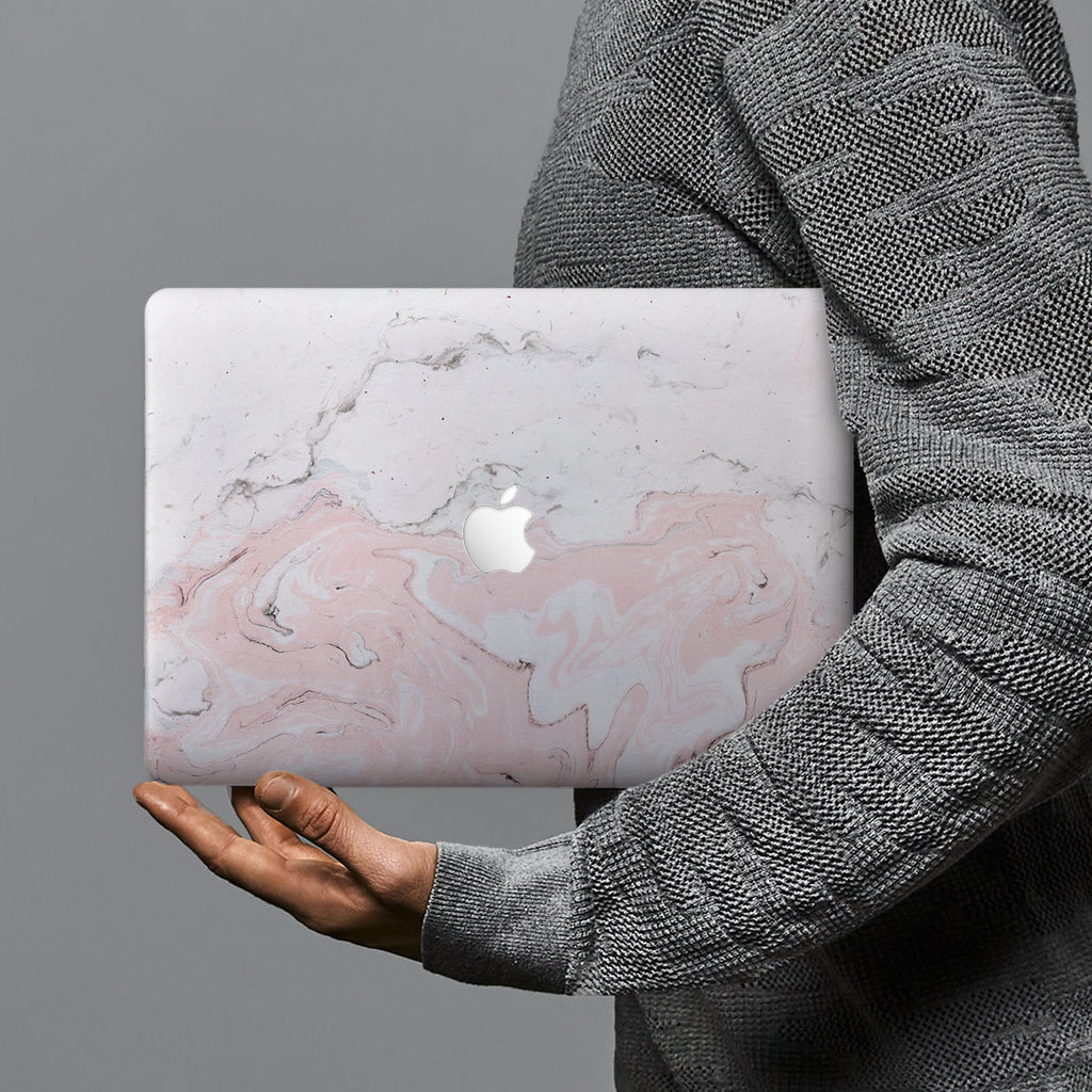 hardshell case with Pink Marble design combines a sleek hardshell design with vibrant colors for stylish protection against scratches, dents, and bumps for your Macbook