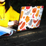 a girl using macbook air with personalized Macbook carry bag case with Halloween design on a wooden table