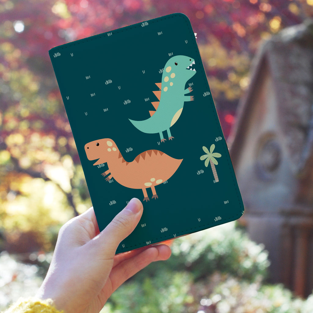 a girl holding personalized RFID blocking passport travel wallet with Dino Party design