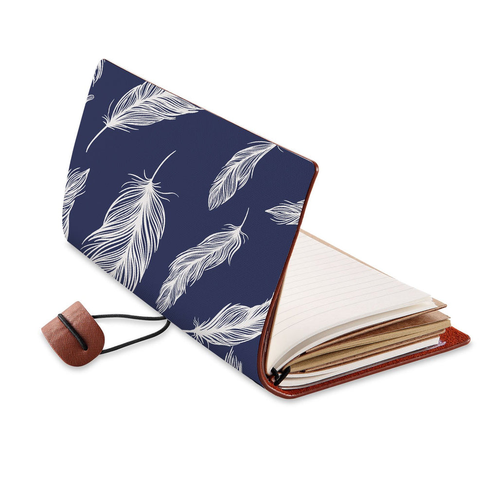 opened view of midori style traveler's notebook with Feather design