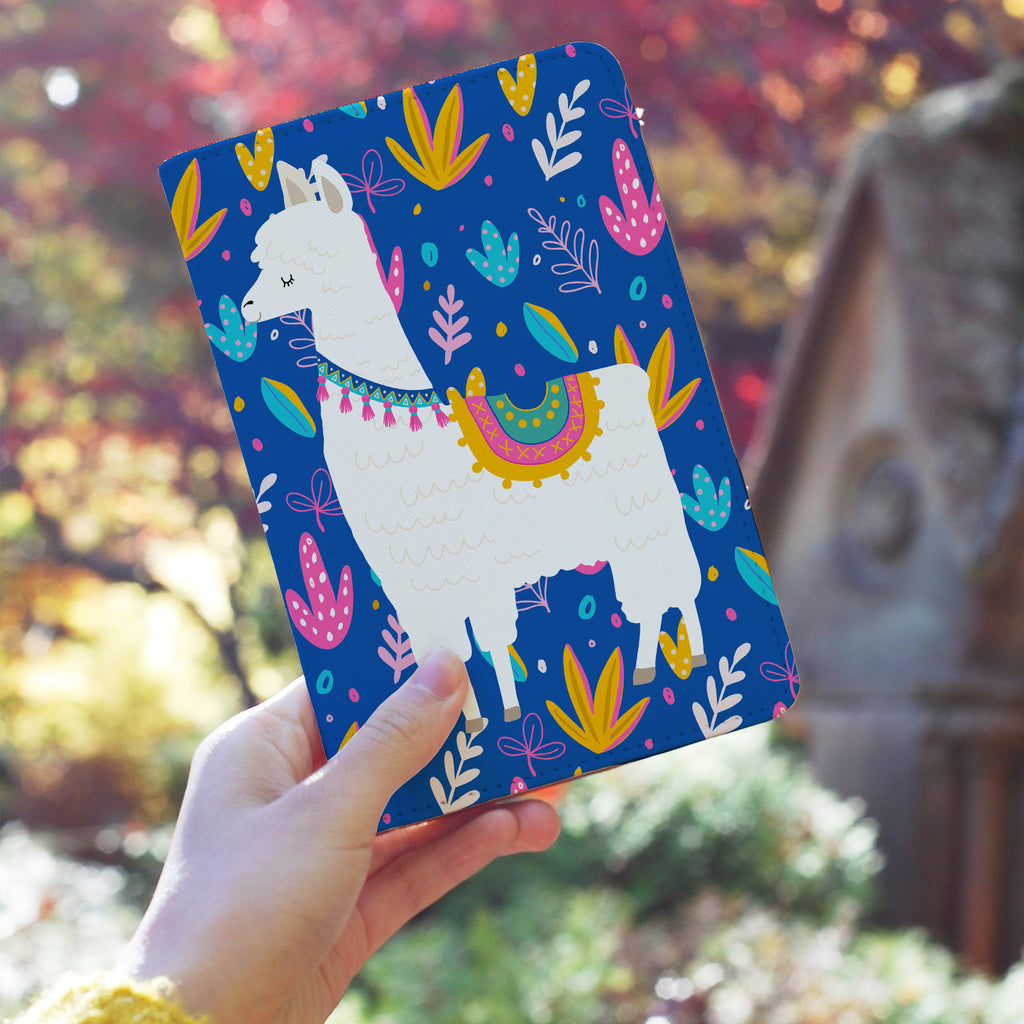 a girl holding personalized RFID blocking passport travel wallet with Llamas design