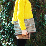 a girl holding personalized Macbook carry bag case with Wood design