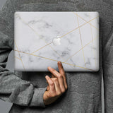 Form-fitting hardshell with Marble 2020 design keeps scuffs and scratches at bay