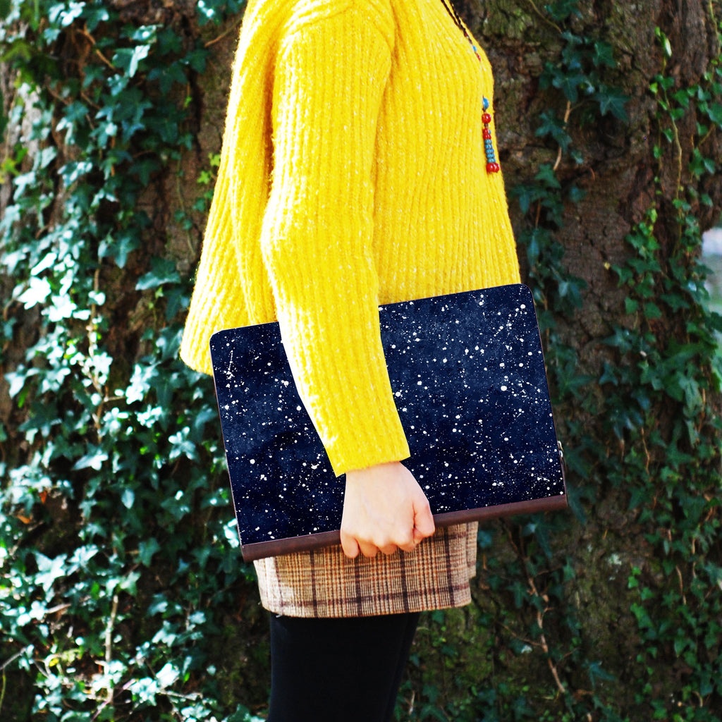 a girl holding personalized Macbook carry bag case with Galaxy Universe design