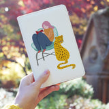 a girl holding personalized RFID blocking passport travel wallet with Urban Jungle design