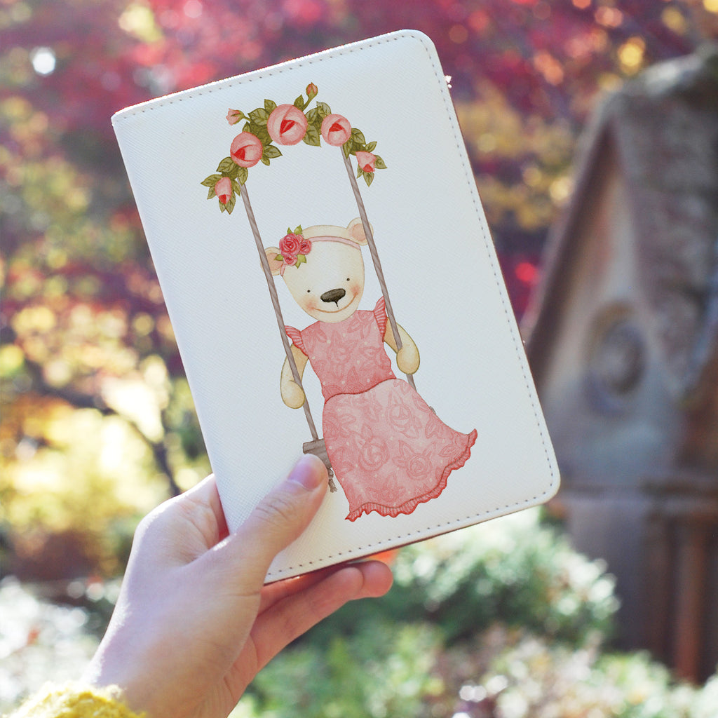 a girl holding personalized RFID blocking passport travel wallet with Charming Bear design