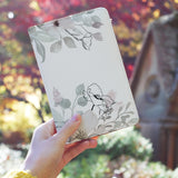 a girl holding personalized RFID blocking passport travel wallet with Blooming Spring design