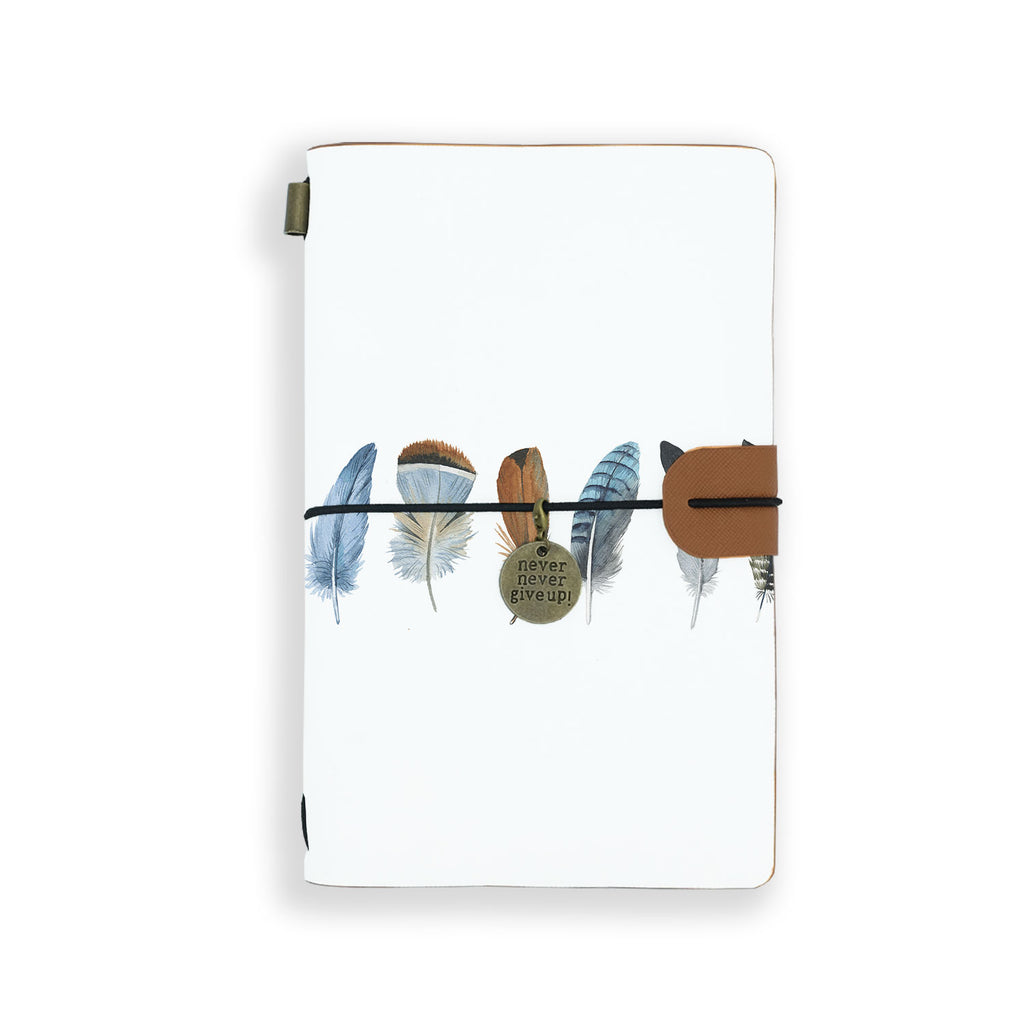 the front top view of midori style traveler's notebook with boho feathers design