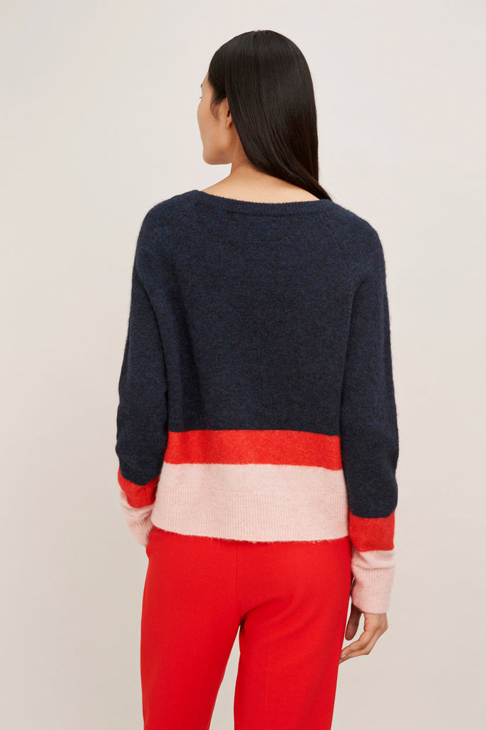 This long sleeve sweater is knitting with blend of wool and alpaca yarns givig it a soft and fluffy surface. Colour blocking adds playful stipes of colour to this cosy crew neck sweater. Center back length is 51cm on size small.