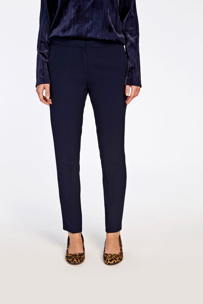 These stylish trousers employ intricate pattern cutting to create the side seam detail to intersect with the waist band. Choose darkest navy for these smart tailored trousers. Inside leg length is 73cm on size small.