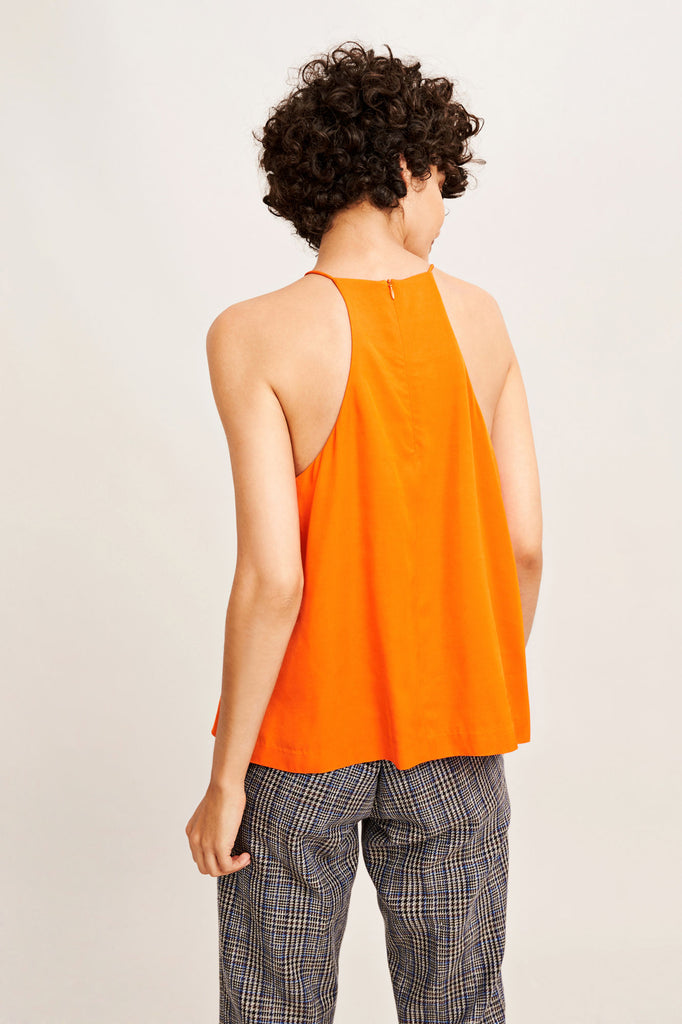 This sleeveless top has been designed with a high neckline and cut-away racer back. An invisible zip fastens the back neck while bust darts add feminine shaping to the front. Center back length is 58cm on size small.