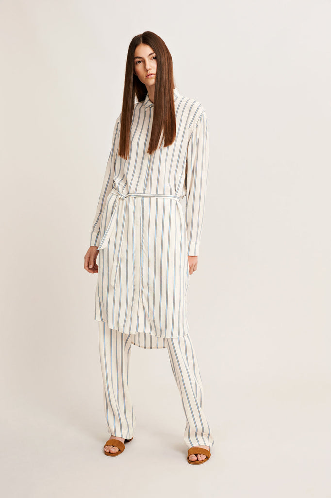 This long sleeve shirt dress is created from 100% silk which features a coloured vertical stripe. A hidden button placket fastens this silk dress which is belted for a defined silhouette.  100% silk.