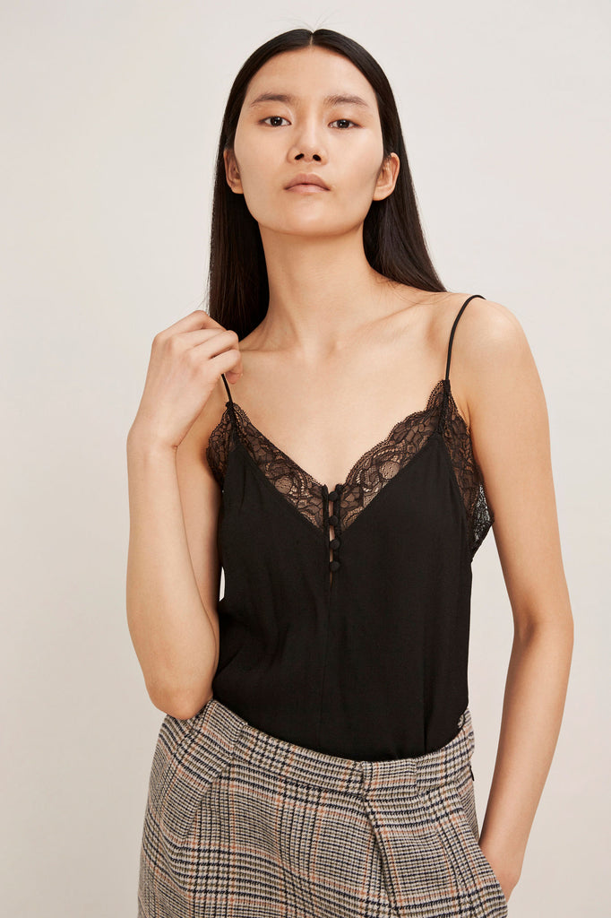 This delicate camisole top has a flattering V-neckline with a button fastening detail. A fine lace border frames the edges, giving a feminine finish to this camisole vest top. Center back length on size small is 30cm.