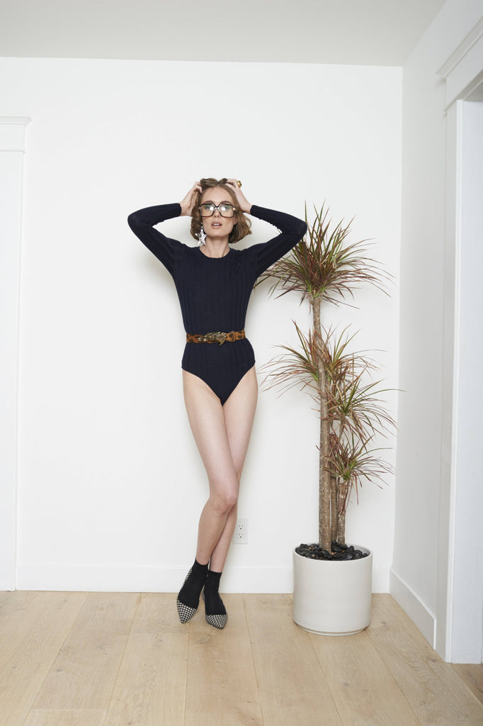 "Madeleine Thompson believes that luxurious knitwear should be ""beautiful and elegant but not predictable"".  This luxurious fitted cashmere bodysuit will quickly become a wardrobe staple!"