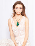 Stunning 18 karat gold malachite feather pendant from Nocturne.  Adds a bit of glamour to any outfit.