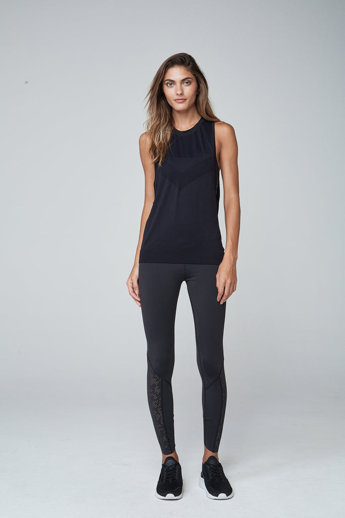 An active style staple; wear with all your workout looks. Designed to allow you freedom to move with dropped arm holes and a relaxed fit but with high neckline for coverage on your chest.  High neckline Dropped arm holes