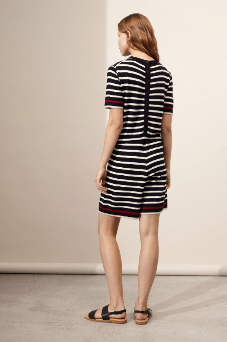 This ultra-soft merino wool playsuit combines a playful summer style with timeless Breton stripes. Featuring a flattering relaxed fit and classic crew-neck, the navy and cream colourway is accented with a vibrant red trim, adding a luxe contemporary twist to this traditional pattern.