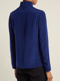 This cobalt-blue silk-crepe Eve top encapsulates Goat's discreetly elegant aesthetic perfectly. It's cut to a slightly relaxed silhouette with long sleeves, and complete with slender pleats across the band collar and cuffs. Style it as part of a smart city look, tucked into high-rise tailored trousers and finished with plush velvet loafers.