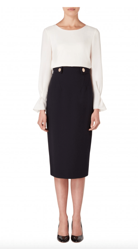 The Evette is a fitted pencil skirt featuring a flattering diagonal dart detailing on the front and back. The waistband features gorgeous gold snap embellishments to add an extra elegant touch.  100% Wool Crepe