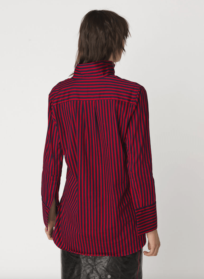 Taking its cue from menswear styles, By Malene Birger's flexible stretch-cotton shirt is woven with vertical stripes to elongate your frame. Fitted through the bodice to define your waist, it is detailed with a stand up collar and rounded hems. Layer this versatile piece over cropped jeans.