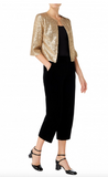 The metallic gold bolero style Evon jacket exudes party- glamour. Made from light-weight stretchy fabric the Evon is slim across the shoulders but easy to layer due to the fit of the elbow-length sleeves and hem. Perfect for throwing over a simple top and tailored trousers or a dress to add party sparkle!  100% polyester. Full lined. Dry clean only. Made in Great Britain.