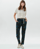 Fun and flirty blue palm printed trousers.  Pair with a little white tee for a lovely summer day!  100% viscose.