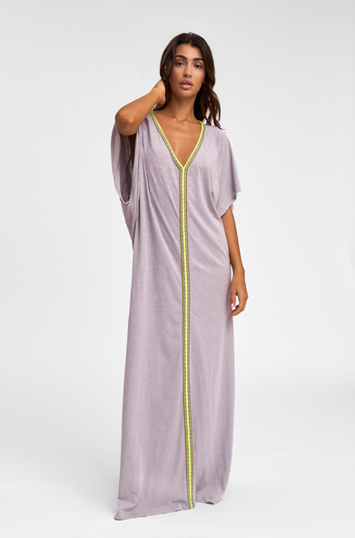 A light and colorful adaptation of the Middle Eastern Abaya. The Pima Abaya is a cotton maxi dress edged in Pitusa's signature Inca trim.