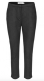 Cropped neoprene pants with side pockets and zipper closure at the front. The pants are menswear-inspired but with a feminine cut and they look great with a small boot.
