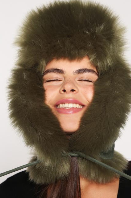 If you've never been a hat person, you will be now! The Helmet allows you to stay snug and stylish in sub-zero temperatures! Lined with fluffy faux fur, its stylish and suede toggles, slip in and smile.