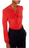 Elegant crepe de chine blouse with pussybow tie at the front neckline from Goat.  Body skimming shape with full length sleeves gathered into cuffs. Invisible centre back zip closure.