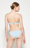 Marysia's renowned Antibes Top is their best-selling strapless icon. Raw, hand cut, scalloped edges trim this classic silhouette, with boning that provides the flattering shape the Antibes is best known for. In a seasonal color - Pool.