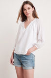 Channel your inner boho with this pretty white top from Velvet.  With a relaxed shape, an unfinished hem and three quarter length sleeves this is the perfect summer top.  Pair with your denim or shorts for an easy everyday look.