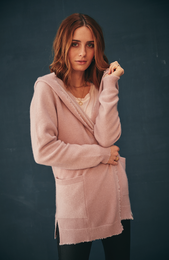 A gorgeous cashmere cotton blend hooded cardi from our favourite knitwear brand Henry Christ.  Crafted from only the finest cashmere and cotton this is just want you want to wrap up in this winter.  In a beautiful soft pink the second you put this on you will feel the quality.  Perfect for lounging in or running around but also pretty  over a silk slip dress.